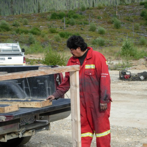 Local help from the community of Tsay Keh Dene. Core cutter Henry Isaac
