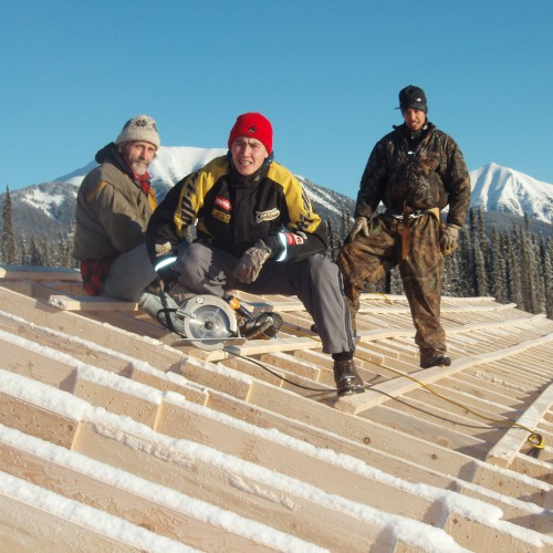 Construction crew from Kwadacha building snow rooves over camp bunkhouse in 2007